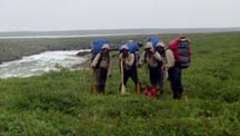 4-paddlers-with-packs-small